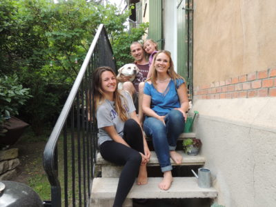 photo with a french host family on stairs outside